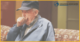 an elderly man coughing