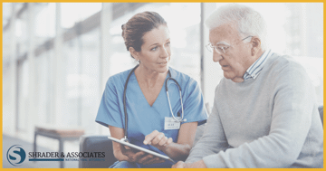 a nurse explaining something to an elderly person